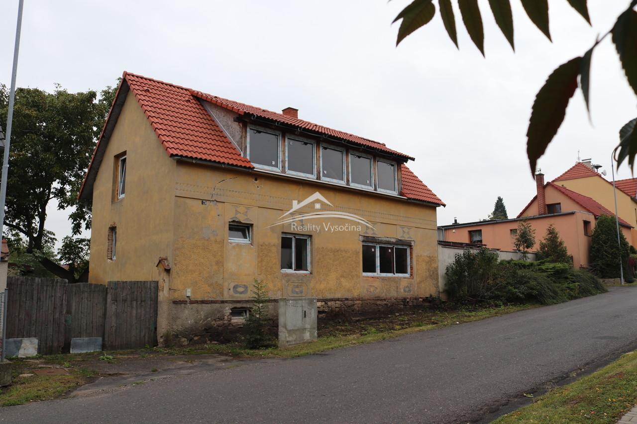 Rodinný dům v obci Bělušice, okres Most.